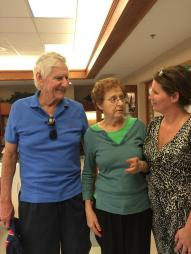 Director of Client Care at Tree of Life Senior Care, spending time with a resident and her husband