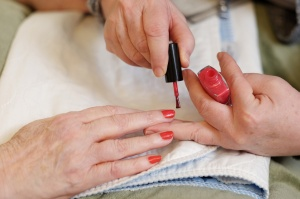 Tree of Life Senior caregiver is painting nails for senior