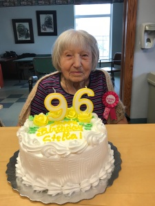 senior lady with a birthday cake